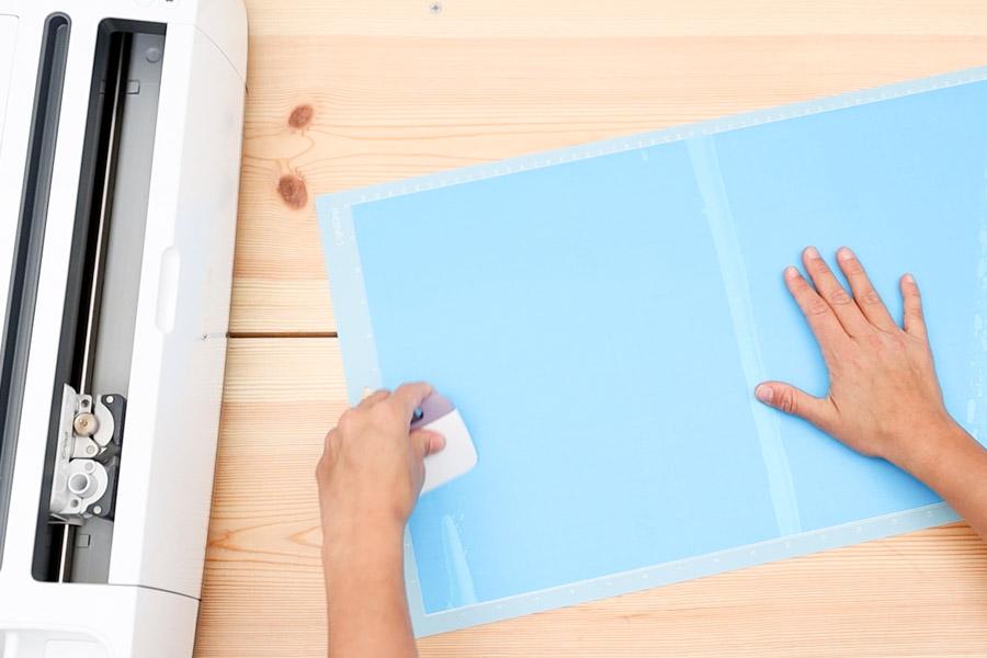 placing stencil vinyl on cricut mat