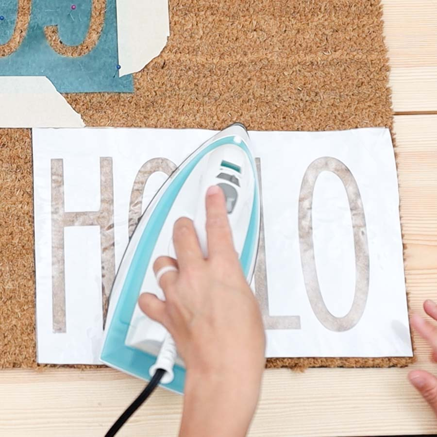 using an iron to transfer freezer paper to doormat