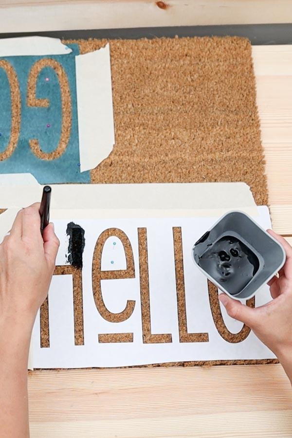 painting doormat on freezer paper stencil