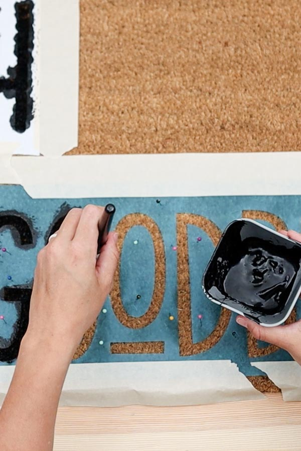 painting doormat on stencil vinyl